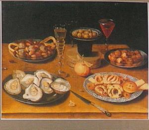 Stilleven met oesters, koekjes en glaswerk