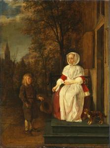 Jonge vrouw geeft een aalmoes aan een bedelende jongen