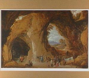 Landschap met reizigers en zigeuners in een grot