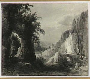 Rotslandschap met figuren op een brug