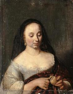 Jonge vrouw die een citroen schilt