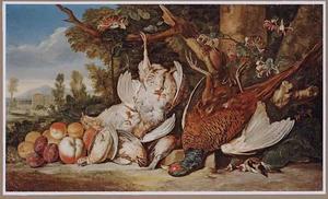 Een dode fazant, patrijzen, vinken en kwartels met vruchten in een Italianiserend landschap