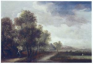 Landschap met een bomenlaan met wandelaars