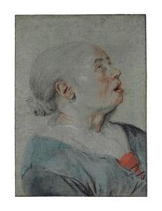 Kop van een omhoog kijkende vrouw