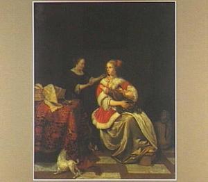 Interieur met een vrouw met een kind op haar schoot en een dienstmeid