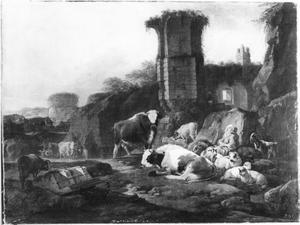 Herders met hun kudde bij een ruïne