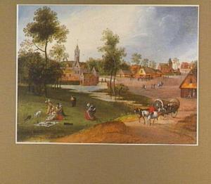 Landschap met een picknickend gezelschap bij een landhuis nabij een dorp