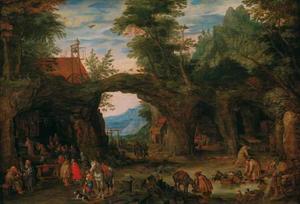 Rotslandschap met een grot waarin een mis wordt opgedragen, rechts een grot met een smidse