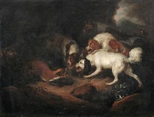 Boslandschap met drie jachthonden en een vos