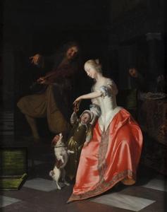Vioolspeler met vrouw en kind die met een hondje spelen