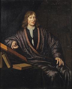 Portret van een jongeman gezeten aan een tafel met boeken