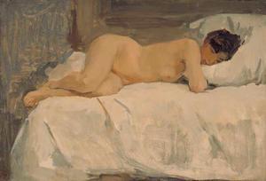 Liggend vrouwelijk naakt op divan