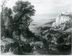 Rotslandschap met herder en hun geiten bij een waterstroom