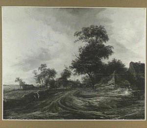 Duinlandschap met boerderij aan een weg