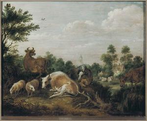 Koeien en schapen in een landschap