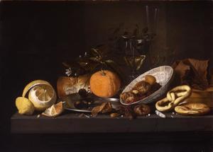 Stilleven met zuidvruchten, twee wijnglazen en een krakeling op een stenen plint