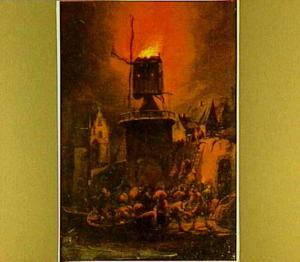Brandende molen bij nacht