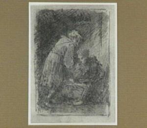 Man, vrouw en kind bij een wieg