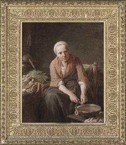 Vrouw die wortels aan het snijden is