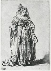 Jonge vrouw in Oosters kostuum met hoofddeksel