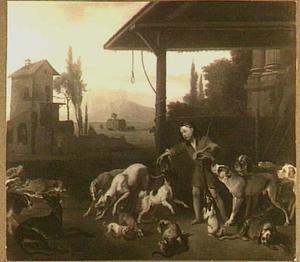 Een jongen voert honden op een erf