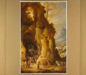 Berglandschap met een grot waarin een mis wordt opgedragen