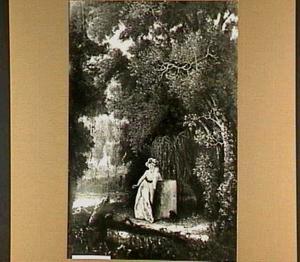 Rouwende jonge vrouw bij grafzerk een in een parkachtig