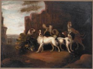 Zes jachthonden in een heuvellandschap bij een kasteel