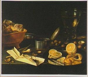 Stilleven van rookgerei, een roemer, een brandende vuurtest, een zilveren bord met een deels geschilde citroen en een tinnen bord met olijven