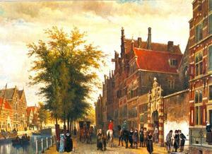 Oudezijds Voorburgwal te Amsterdam met rechts de toegangspoort van het Atheneum Illustre in de Agnietenkapel