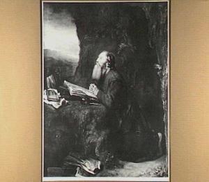 Biddende heremiet in een grot