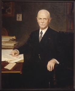 Portret van een man in zijn studeerkamer