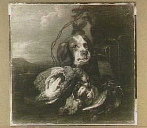 Hond bij buit van gevogelte en vogelkooi in een landschap