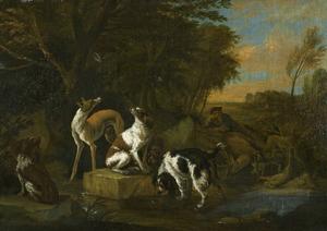 Jager met twee honden bij een buit van haas en gevogelte