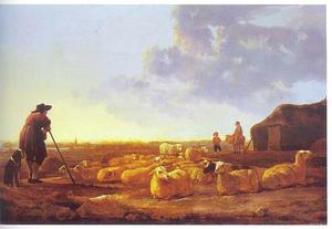 Herder met een kudde schapen op een weide