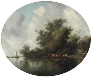 Rivierlandschap met runderen in een veerboot