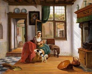 Jonge breiende vrouw in een interieur