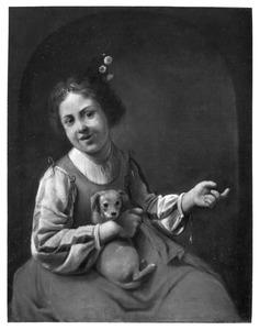 Een meisje met een jonge hond op schoot