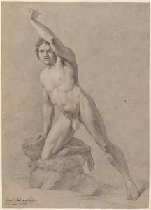 Mannelijk naakt met zijn knie op een rots leunend