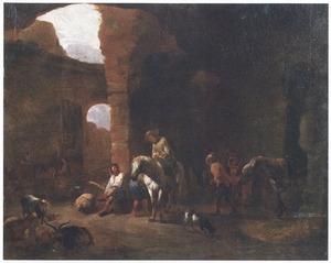 Halthoudende reizigers op de binnenplaats van een herberg in een ruïne