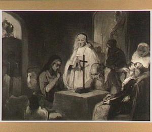 Treurscène om een tafel met een kruis