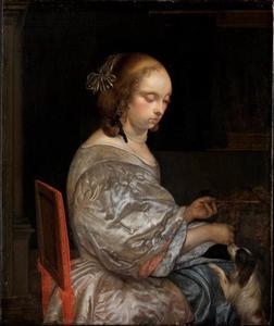 Jonge vrouw met een schoothondje