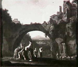 Herders onder een grote brug over een rivierbedding in een bergachtig landschap