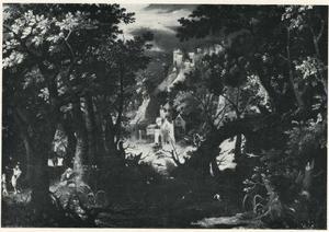 Boslandschap met een jager en kastelen  op de achtergrond