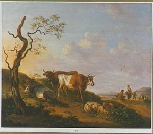 Landschap met koeien en schapen bij een kale boom