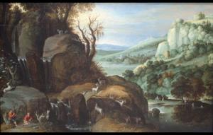Rotslandschap met herders en hun geiten bij een waterstroom