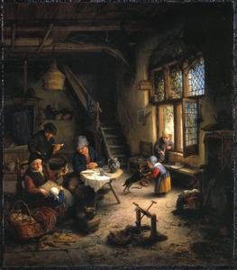 Familie in een boerderij-interieur