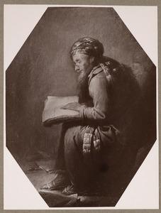 Oude geleerde met tulband die een boek leest