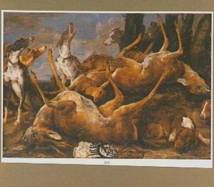 Jachthonden met jachtbuit onder een boom