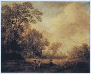 Boslandschap met twee jagers en hun hond op een pad